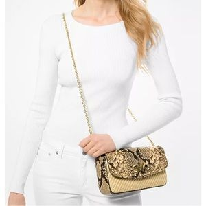 Micheal Kors Izzy large straw clutch